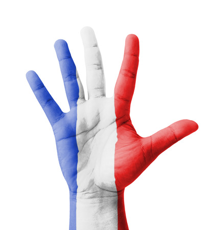 Open hand raised, multi purpose concept, France flag painted - isolated on white background photo