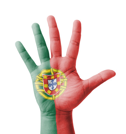 Open hand raised, multi purpose concept, Portugal flag painted - isolated on white background photo