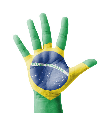 Open hand raised, multi purpose concept, Brazil flag painted - isolated on white background