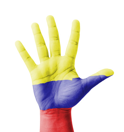 Open hand raised, multi purpose concept, Colombia flag painted - isolated on white background photo