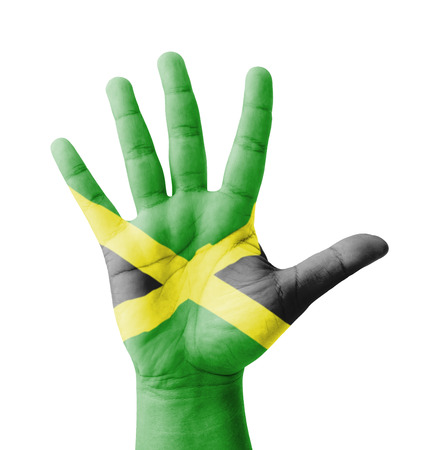 Open hand raised, multi purpose concept, Jamaica flag painted - isolated on white background Stock Photo