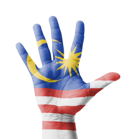 Open hand raised, multi purpose concept, Malaysia flag painted - isolated on white background