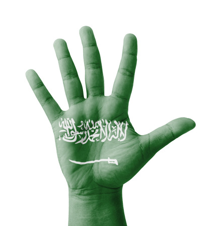 Open hand raised, multi purpose concept, Saudi Arabia flag painted - isolated on white background photo