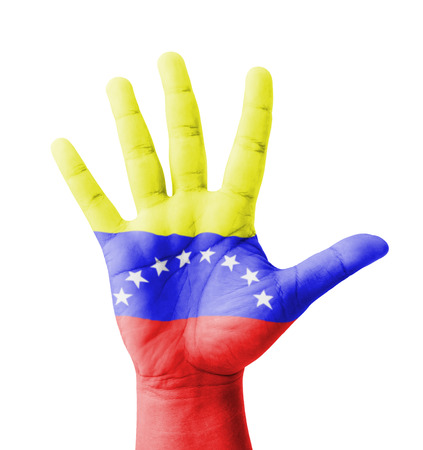 Open hand raised, multi purpose concept, Venezuela flag painted - isolated on white background photo