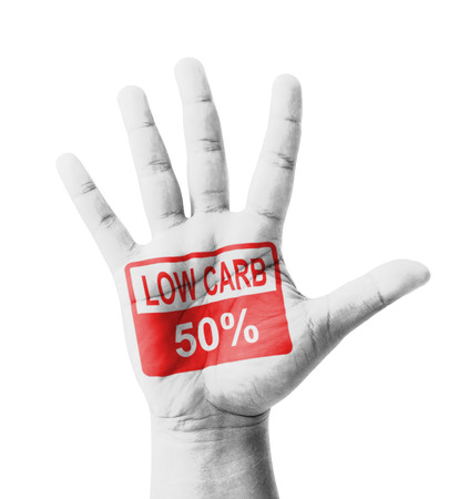 Open hand raised, Low Carbohydrate 50% sign painted, multi purpose concept - isolated on white background photo