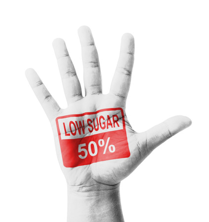 Open hand raised, Low Sugar 50% sign painted, multi purpose concept - isolated on white background photo