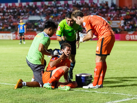 SISAKET THAILAND-MAY 21  Santirat Viang-in of Sisaket FC   orange  in action during Thaicom FA Cup between Sisaket FC  and Angthong FC  at Sri Nakhon Lamduan Stadium on May 21,2014,Thailand