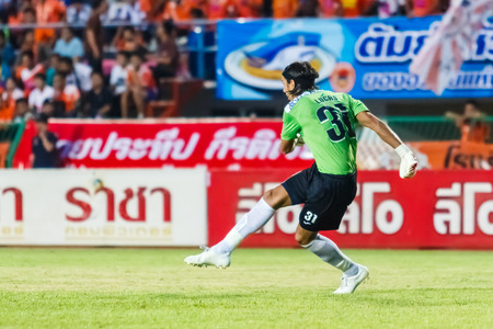 diving save: SISAKET THAILAND-MAY 28: Lucas Daniel of Sisaket FC. in action during Thai Premier League between Sisaket FC and Chonburi FC at Sri Nakhon Lamduan Stadium on May 28,2014,Thailand