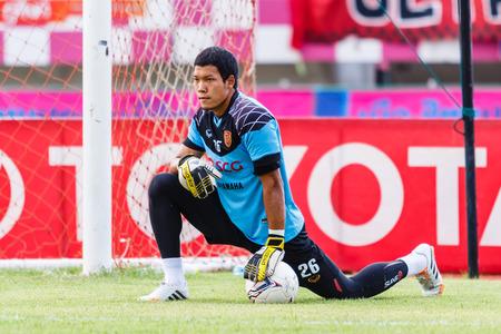 diving save: SISAKET THAILAND-JUNE 8: Kawin Thamsatchanan of Muangthong Utd. in action during a training ahead Thai Premier League between Sisaket FC and Muangthong Utd at Sri Nakhon Lamduan Stadium on June 8,2014,Thailand