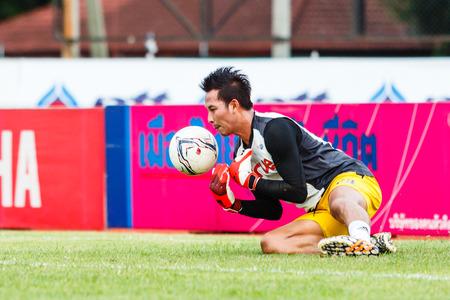 diving save: SISAKET THAILAND-JUNE 29: Pisan Dorkmaikaew of Bangkok Utd. in action during a training ahead Thai Premier League between Sisaket FC and Bangkok Utd at Sri Nakhon Lamduan Stadium on June 29,2014,Thailand Editorial
