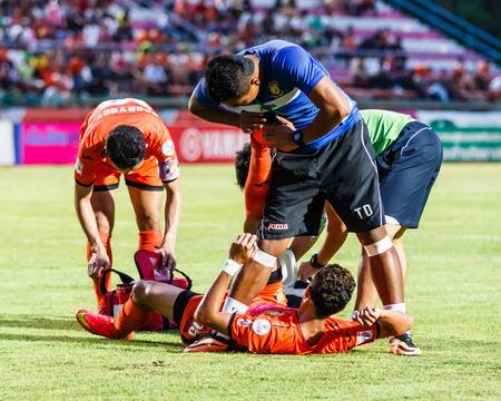 SISAKET THAILAND-JULY 23: First aid team of Sisaket FC. (blue) in action during Thai Premier League between Sisaket FC and Songkhla Utd at Sri Nakhon Lamduan Stadium on July 23,2014,Thailand