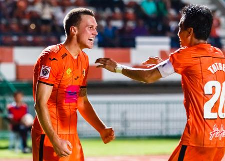 brent: SISAKET THAILAND-JULY 23: Brent McGrath of Sisaket FC. (orange) in action during Thai Premier League between Sisaket FC and Songkhla Utd at Sri Nakhon Lamduan Stadium on July 23,2014,Thailand