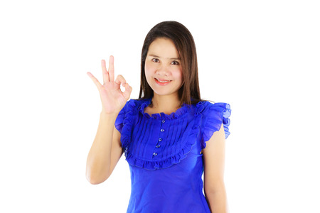 Asian woman showing ok sign isolated on white background photo