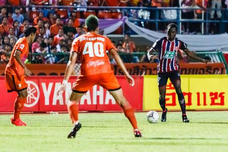 gilbert: SISAKET THAILAND-AUGUST 3: Gilbert Koomson of BEC Tero Sasana FC. (blue) in action during Thai Premier League between Sisaket FC and BEC Tero Sasana FC at Sri Nakhon Lamduan Stadium on August 3,2014,Thailand