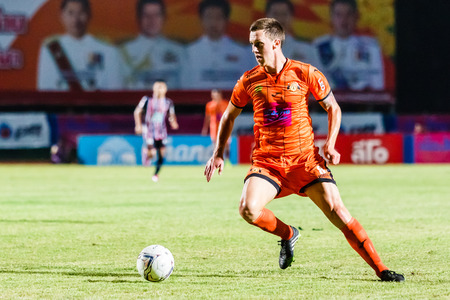 brent: SISAKET THAILAND-AUGUST 3: Brent McGrath of Sisaket FC. (orange) in action during Thai Premier League between Sisaket FC and BEC Tero Sasana FC at Sri Nakhon Lamduan Stadium on August 3,2014,Thailand