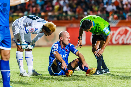 first australians: SISAKET THAILAND-AUGUST 13: Trent McClenahan of PTT Rayong FC. (blue) in action during Thai Premier League between Sisaket FC and PTT Rayong FC at Sri Nakhon Lamduan Stadium on August 13,2014,Thailand