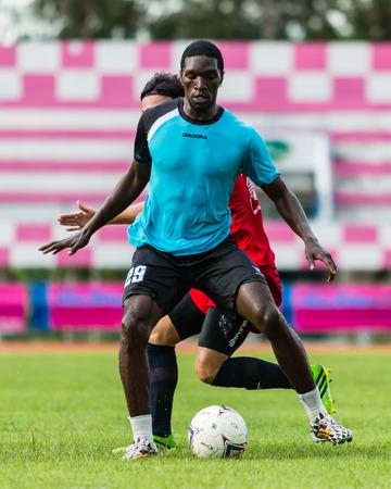 sa: SISAKET THAILAND-September 17: Etoundi Pie Claude of Sisaket Utd. in action during Unofficial Friendly Match between Sisaket FC and Sisaket Utd at Sri Nakhon Lamduan Stadium on September 17,2014,Thailand