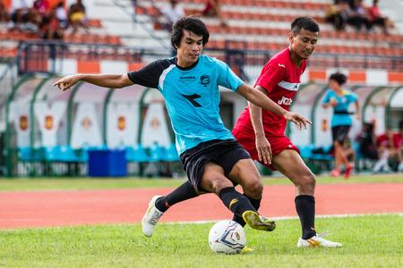 unofficial: SISAKET THAILAND-September 17: Mangkorn Noichomphu of Sisaket Utd. in action during Unofficial Friendly Match between Sisaket FC and Sisaket Utd at Sri Nakhon Lamduan Stadium on September 17,2014,Thailand