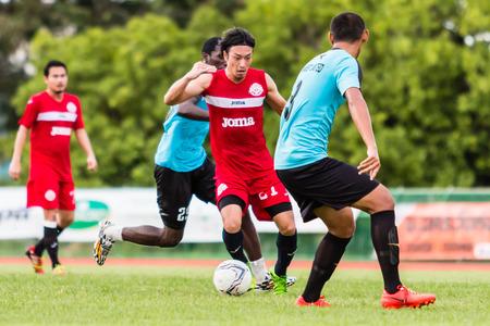unofficial: SISAKET THAILAND-September 17: Terukazu Tanaka of Sisaket FC. in action during Unofficial Friendly Match between Sisaket FC and Sisaket Utd at Sri Nakhon Lamduan Stadium on September 17,2014,Thailand