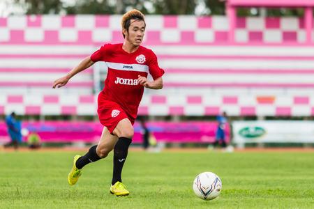 sa: SISAKET THAILAND-September 17: Nuttawut Khamrin of Sisaket FC. in action during Unofficial Friendly Match between Sisaket FC and Sisaket Utd at Sri Nakhon Lamduan Stadium on September 17,2014,Thailand