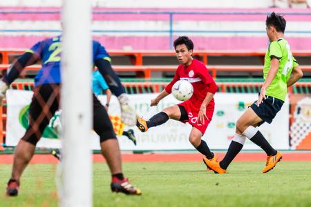 unofficial: SISAKET THAILAND-September 17: Tatree Seeha of Sisaket FC. in action during Unofficial Friendly Match between Sisaket FC and Sisaket Utd at Sri Nakhon Lamduan Stadium on September 17,2014,Thailand