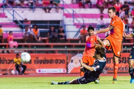 brent: SISAKET THAILAND-September 21: Brent McGrath of Sisaket FC. shooting ball during Friendly Match between Sisaket FC and Roi Et Utd at Sri Nakhon Lamduan Stadium on September 21,2014,Thailand Editorial