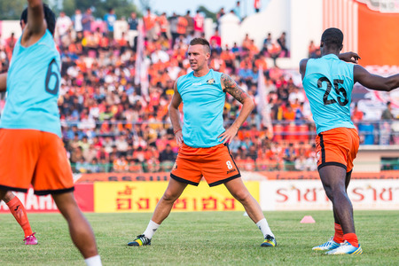 brent: SISAKET THAILAND-October 15: Brent McGrath of Sisaket FC. in action during a training ahead Thai Premier League between Sisaket FC and Buriram Utd at Sri Nakhon Lamduan Stadium on October 15,2014,Thailand