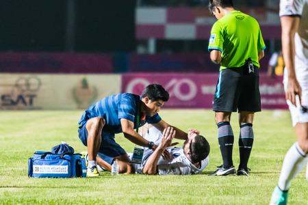 SISAKET THAILAND-OCTOBER 15: First aid team of Buriram Utd. (blue) in action during Thai Premier League between Sisaket FC and Buriram Utd at Sri Nakhon Lamduan Stadium on October 15,2014,Thailand