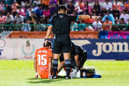 SISAKET THAILAND-OCTOBER 22: The referee (black) in action during Thai Premier League between Sisaket FC and Air Force Central FC at Sri Nakhon Lamduan Stadium on October 22,2014,Thailand