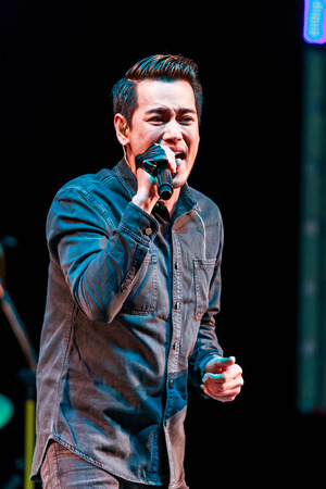 SISAKET, THAILAND - DECEMBER 27 : Aof Pongsak performs live concert during Red Cross Fair 2014 at Sisaket City Hall on December 27, 2014, Thailand