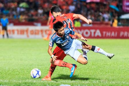 chiangrai: SISAKET THAILAND-MAY 3: Rungrath Poomchantuek of Chiangrai Utd. (blue) in action during Thai Premier League between Sisaket FC and Chiangrai Utd at Sri Nakhon Lamduan Stadium on May 3,2015,Thailand Editorial