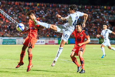 9 ball: SISAKET THAILAND-AUGUST 9: Diogo Luis Santo of Buriram Utd (white) shooting ball during Thai Premier League between Sisaket FC and Buriram Utd at Sri Nakhon Lamduan Stadium on August 9,2015,Thailand