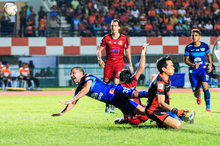 diving save: SISAKET THAILAND-AUGUST 12: Thiago Cunha of Chonburi FC (blue) in action during Chang FA Cup between Sisaket FC and Chonburi FC at Sri Nakhon Lamduan Stadium on August 12,2015,Thailand
