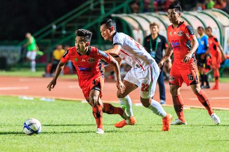 nakhon: SISAKET THAILAND-AUGUST 19: Anucha Suksai of Sisaket FC. (orange) in action during Thai Premier League between Sisaket FC and Muangthong Utd at Sri Nakhon Lamduan Stadium on August 19,2015,Thailand