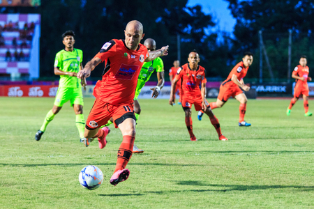 nakhon: SISAKET THAILAND-SEPTEMBER 12: Mohsen Bayatinia of Sisaket FC. (orange) in action during Thai Premier League between Sisaket FC and Suphanburi FC at Sri Nakhon Lamduan Stadium on September 12,2015,Thailand