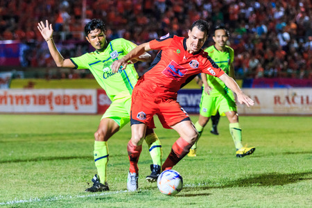 premier league: SISAKET THAILAND-SEPTEMBER 12: Lyuben Nikolov of Sisaket FC. (orange) in action during Thai Premier League between Sisaket FC and Suphanburi FC at Sri Nakhon Lamduan Stadium on September 12,2015,Thailand Editorial