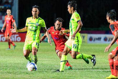 nakhon: SISAKET THAILAND-SEPTEMBER 12: Anucha Suksai of Sisaket FC. (orange) in action during Thai Premier League between Sisaket FC and Suphanburi FC at Sri Nakhon Lamduan Stadium on September 12,2015,Thailand Editorial