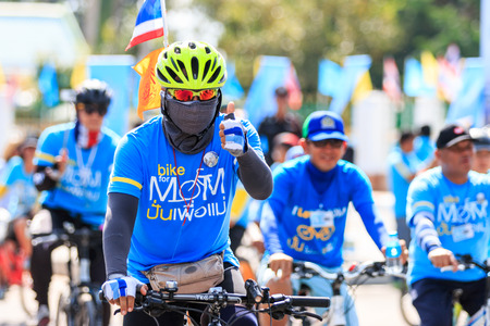 respected: SISAKET,THAILAND-AUGUST 16-2015: This event is Bike for mom from Thailand. Bike for mom event show respected to Queen and makes Thailands cyclists set record for worlds biggest bike ride.