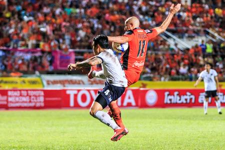 premier league: SISAKET THAILAND-SEPTEMBER 16: Mohsen Bayatinia of Sisaket FC. (orange) in action during Thai Premier League between Sisaket FC and Pattaya Utd at Sri Nakhon Lamduan Stadium on September 16,2015,Thailand