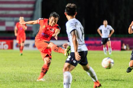 premier league: SISAKET THAILAND-SEPTEMBER 16: Tatree Seeha of Sisaket FC. (orange) shooting ball during Thai Premier League between Sisaket FC and Pattaya Utd at Sri Nakhon Lamduan Stadium on September 16,2015,Thailand