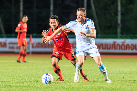 tot: SISAKET THAILAND-SEPTEMBER 20: Anucha Suksai of Sisaket FC. (orange) in action during Thai Premier League between Sisaket FC and TOT SC at Sri Nakhon Lamduan Stadium on September 20,2015,Thailand