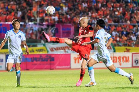 tot: SISAKET THAILAND-SEPTEMBER 20: Mohsen Bayatinia of Sisaket FC. (orange) in action during Thai Premier League between Sisaket FC and TOT SC at Sri Nakhon Lamduan Stadium on September 20,2015,Thailand