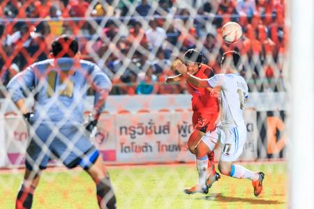 tot: SISAKET THAILAND-SEPTEMBER 20: Pisanu Ngamsa-nguan of Sisaket FC. (orange) in action during Thai Premier League between Sisaket FC and TOT SC at Sri Nakhon Lamduan Stadium on September 20,2015,Thailand Editorial