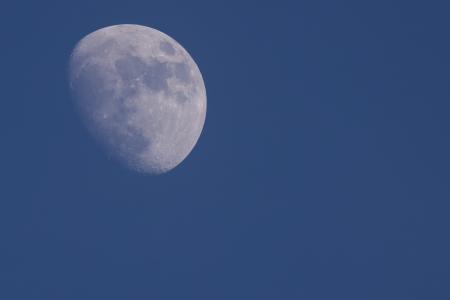 Moon against a blue sky photo