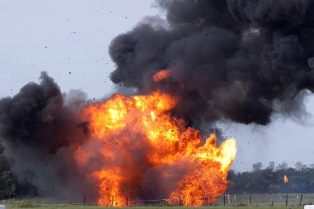 dynamite: Explosion with flying debris Stock Photo
