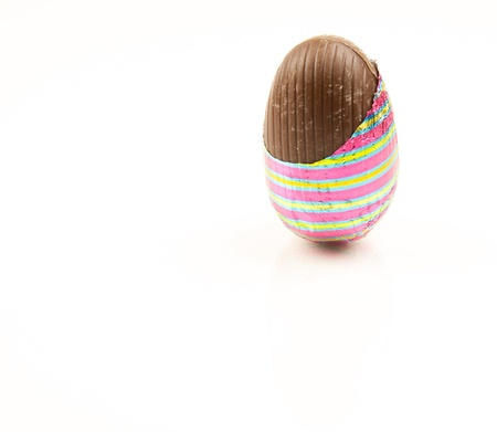 unwrapped: Chocolate easter egg partially unwrapped  Stock Photo