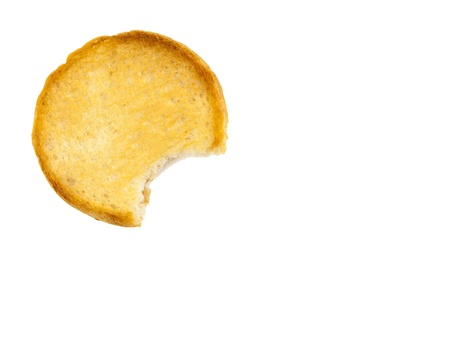 A round rusk with bite missing, isolated on a white background photo