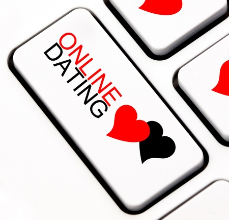 Online dating button with heart shaped talk cloud on keyboard