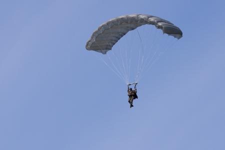 "LEEUWARDEN,FRIESLAND,HOLLAND-SEPTEMBER 17:Paratrooper at the""Luchtmachtdagen"" Airshow on September 17, 2011 at Leeuwarden Airfield,Friesland,Holland  Stock Photo - 13847197"