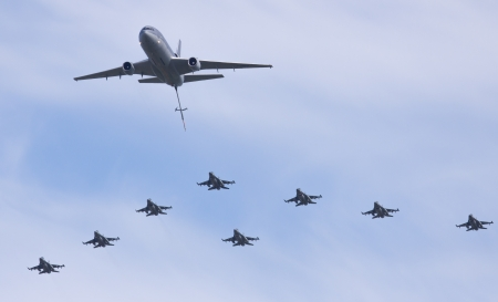 LEEUWARDEN,FRIESLAND,HOLLAND-SEPTEMBER 17: A Dutch F-16 squadron flying in formation with a KDC-10 tanker at the Luchtmachtdagen Airshow on September 17, 2011 at Leeuwarden Airfield,Friesland,Holland